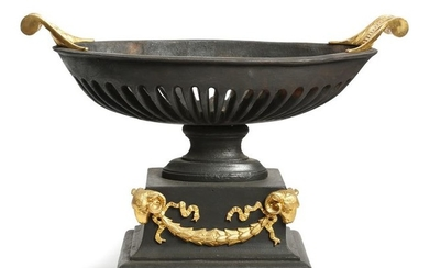 A CAST IRON AND GILT BRONZE MOUNTED BASKET...