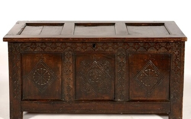 A CHARLES II JOINED OAK CHEST WITH CARVED FRIEZE, STILES AND...