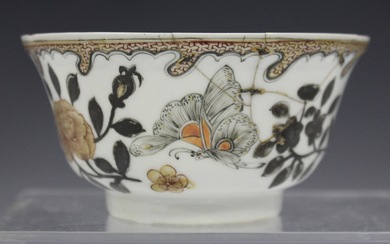 A Chinese porcelain bowl, Yongzheng period, painted en grisaille with butterflies and insects amidst