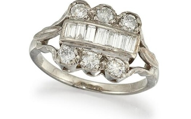 A DIAMOND DRESS RING Centred by a channel-set row of
