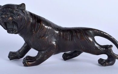 A JAPANESE BRONZE OKIMONO IN THE FORM OF A TIGER,