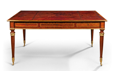 A REGENCY BRASS-MOUNTED AND BRASS-INLAID INDIAN ROSEWOOD AND MAHOGANY WRITING-TABLE