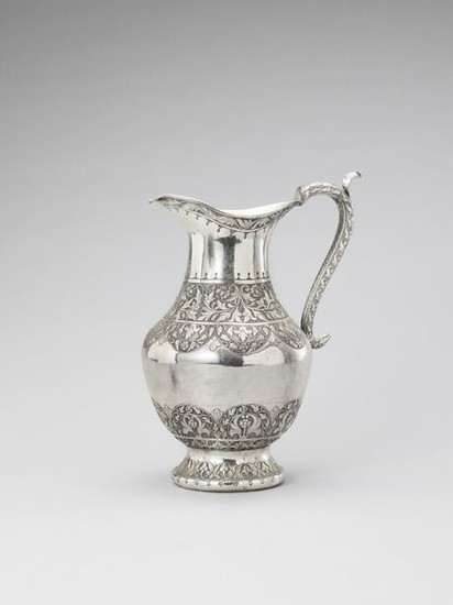 A VERY LARGE SILVER PLATED PITCHER, 19TH CENTURY...
