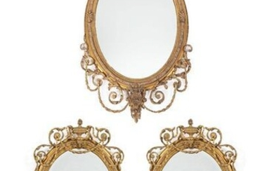 A Victorian Gilt and Gesso Oval Mirror, in Adam style,...