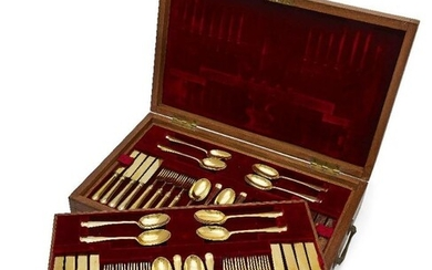 A boxed canteen of silver-gilt cutlery by...