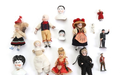 A collection of 19/20th century porcelain and biscuit dolls a.o. Armand Marseilles 3300. H. 3–33 cm.