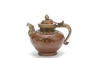 A copper alloy ewer and cover with silver-inlaid brass mounts