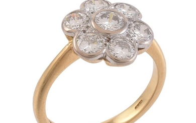 A diamond flower head cluster ring
