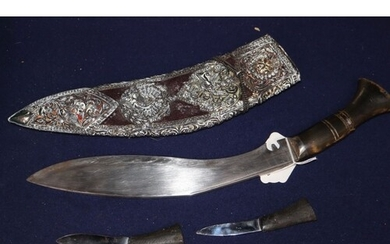 A late 19th century horn handled kukri, with white metal mou...
