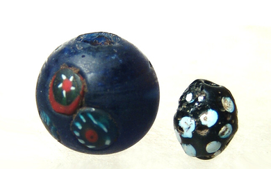 A lovely little pair of glass beads