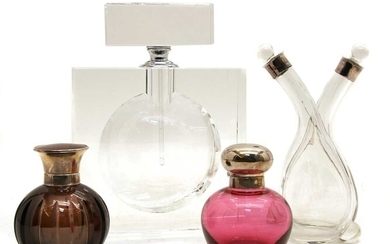 A modern clear glass scent bottle and stopper