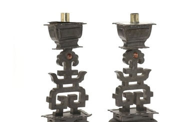 A pair of Chinese Qing c. 1900 pewter altar candlesticks. H. 34 cm. (2)