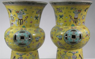 A pair of Chinese gu-form enameled garden stools late...