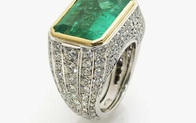 A ring with emerald and brilliant cut diamonds