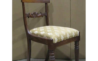 A set of four 19th century rosewood bar back dining chairs w...