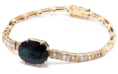 AN 18CT GOLD SAPPHIRE AND DIAMOND BRACELET; centring a dark blue oval cut sapphire of approx. 11.7ct (12.16 x 16.59mm) adjacent to s...