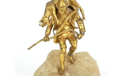AN AUSTRIAN 9TH CENTURY GILT BRONZE AND ONYX FIGURE Solitary...