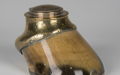 An Edwardian brass mounted horse hoof inkwell, the hinged lid detailed 'Red Lancer 1882-1902