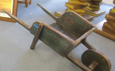 An early 20th century green painted and polished pine child'...