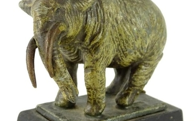 An early 20thC cold painted spelter figure of an elephant, i...