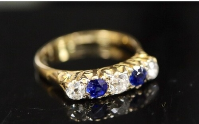 An early/mid 20th century 18ct gold and platinum, two stone ...