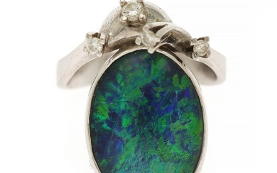 An opal and diamond ring set with an opal cabochon and four brilliant-cut diamonds, mounted in 14k white gold. Size 52.