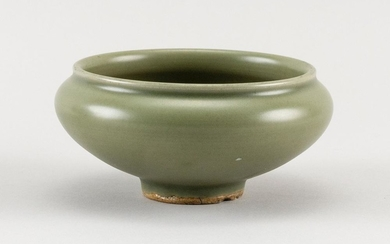 """CHINESE LONGQUAN CELADON PORCELAIN BOWL In ovoid form. Remnants of old label and deaccession mark near foot. Height 2.5"""". Diameter 4""""."""