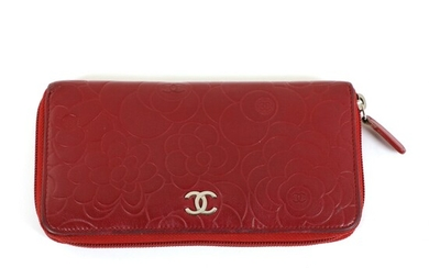 "Chanel: A ""Floral Embossed Zip Around Wallet"" of dark red embossed skin with two compartments divided by a zip pocket and with several card slots."
