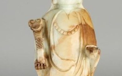 Chinese jade Buddha with mace on wooden console. 20th