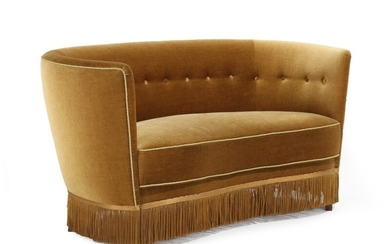 Danish furniture design: Curved sofa with stained beech legs, upholstered with yellow velour, fitted with buttons, below with fringes. 1930–40s. L. 150 cm.