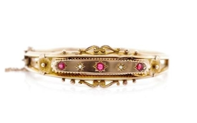Edwardian 9ct rose gold bangle set with red gemstones and ro...