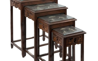 Set of 4 nesting tables. Chinese style. 20th century. Carved, openwork wood, with applications in resin and polychromy.