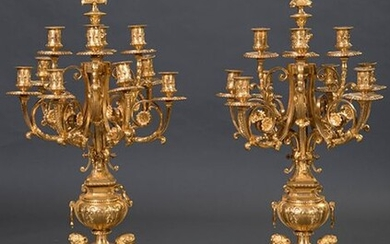 Large pair of ten-light candlesticks in mercury-golden bronze, Napoleon III, France, c. 1860. Vase shaped shaft with decoration of female busts and laurel garlands. Height: 95 cm. Exit: 10000uros. (1.663.860 Ptas.)