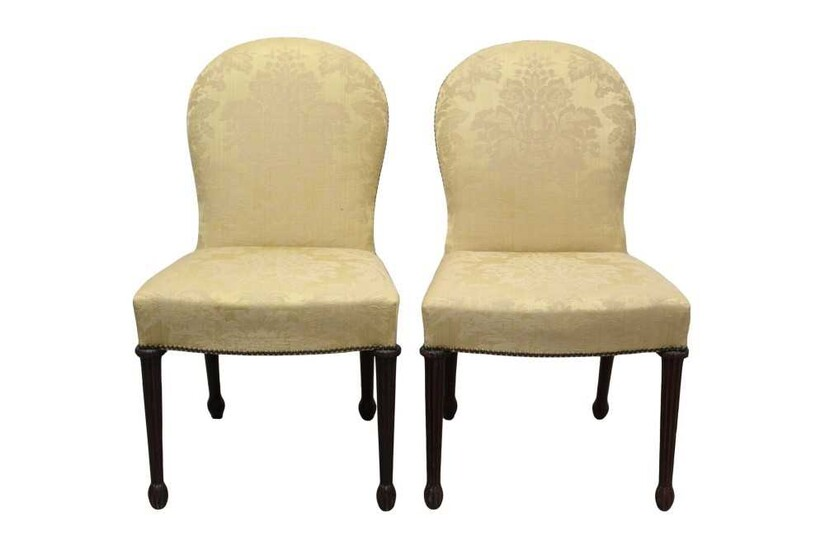 Pair of Mid-18th century style Continental mahogany upholstered side chairs, each with arched lemon silk damask upholstered back and fluted legs