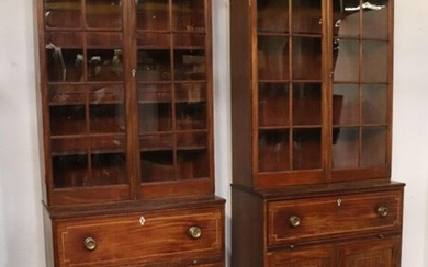 Pair of bookcases in mahogany, mahogany veneer and marquetry of light wood fillets.