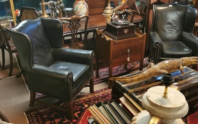 Pair of early 20th. C. black leather wingback chairs with br...