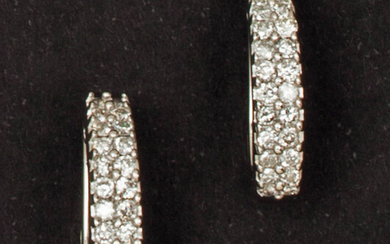 Pair of white gold earrings, each adorned with...