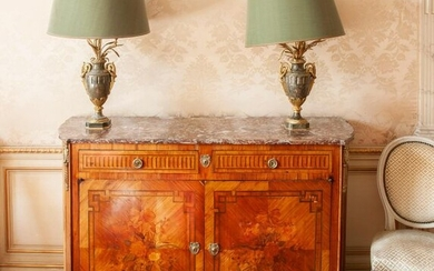 Rosewood and violet veneer sideboard with high rests, it has two drawers on the front simulating grooves in reserves and opens with two doors in the lower part decorated with floral bouquets bordered with Greek-style reserves. Grey marble top with...