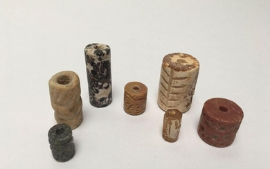 Set of seven engraved cylinder seals decorated with characters, animals, geometric figures...Hard stone, quartz and granite.