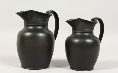 TWO PLAIN WEDGWOOD BLACK BASALT MILK JUGS. (2)