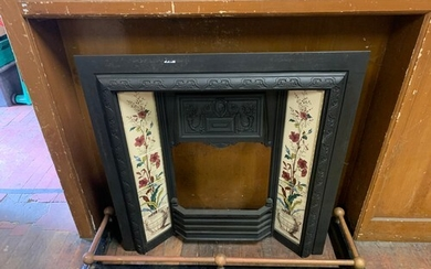 Vintage cast iron fire place decorated with hand painted til...