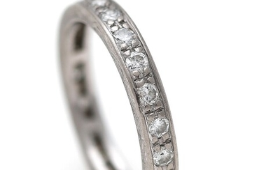 Willy Junget: A full diamond eternity ring set with numerous brilliant-cut diamonds weighing a total...