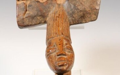 Yoruba, carved wooden Shango staff, with a seated...