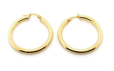 18ct yellow gold hoop earrings marked 750. Approx width 30mm...