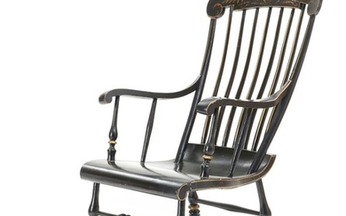 A 19th century black lacquered and gilded rocking chair.