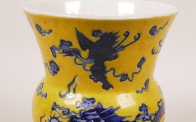 A Chinese yellow glazed porcelain vase with blue and white d...