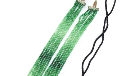 A MULTI STRAND GREEN TOURMALINE BEAD NECKLACE; 6 strands of graduated faceted green tourmaline beads 2.6-3.3mm to black silk chord a...