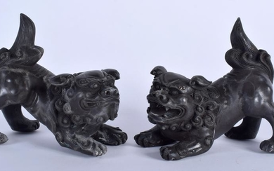 A PAIR OF CHINESE BRONZE DOGS OF FOE, formed upon all
