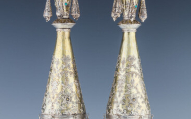 A PAIR OF GILDED SILVER TORAH FINIALS. Probably Israel,...
