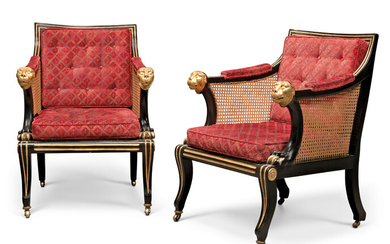 A PAIR OF REGENCY REVIVAL PARCEL-GILT AND 'BRONZED' CANED LIBRARY BERGERES